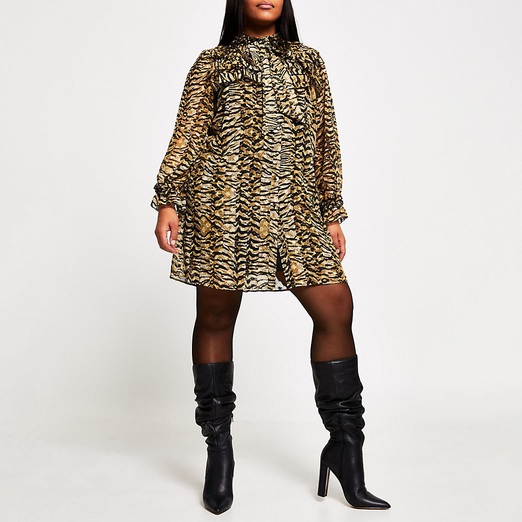 model wearing leopard print dress with tights and boots