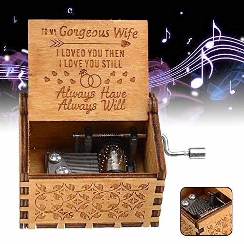 A wooden box with a message for a wife engraved in it