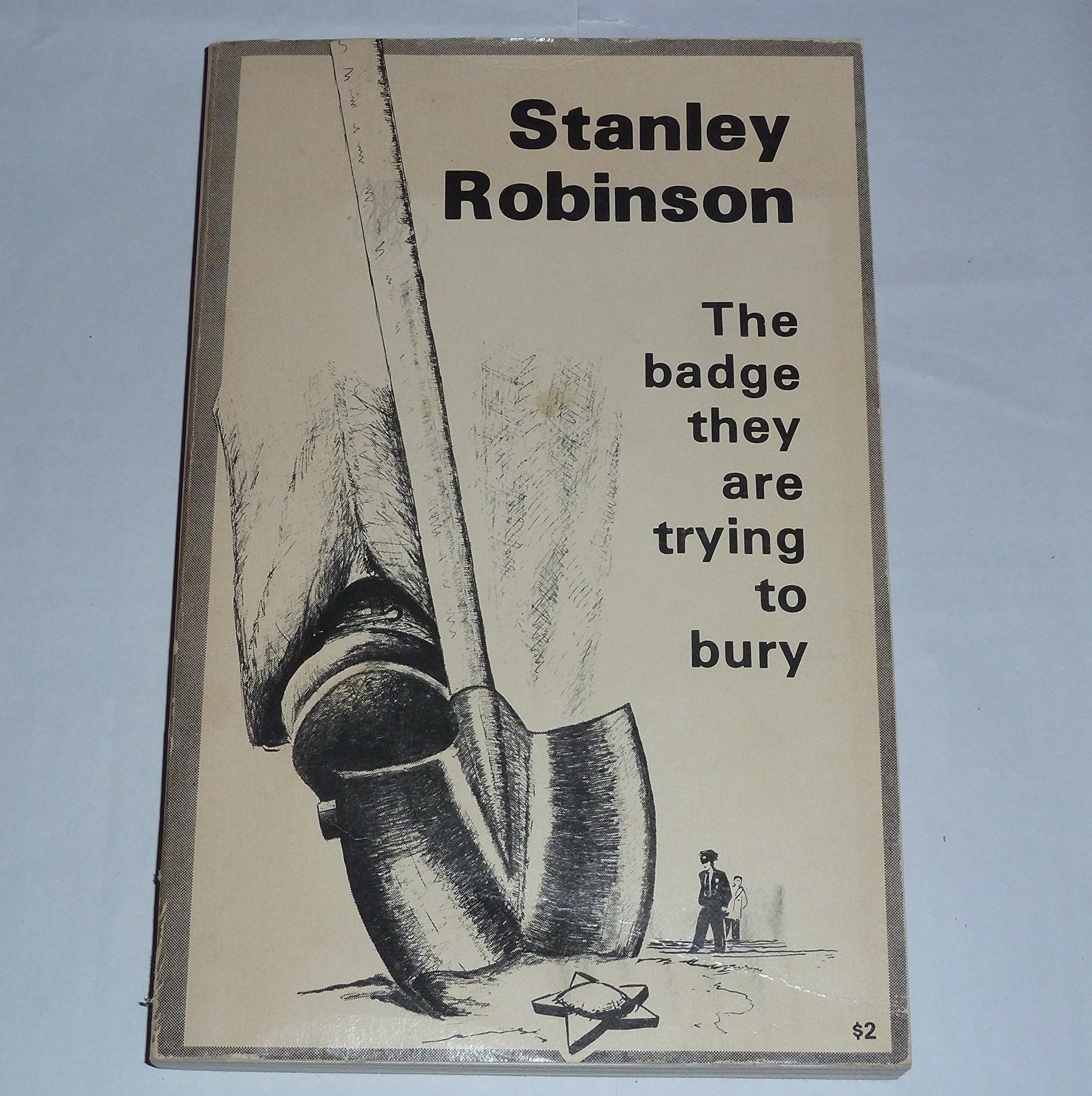 Cover of the book showing a drawing of someone using a shovel to bury a police badge