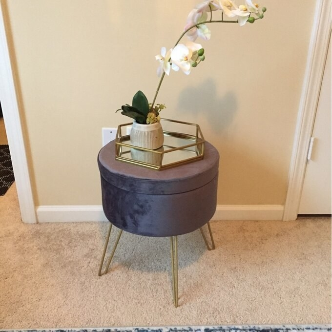 purple storage ottoman with a tray on top of it