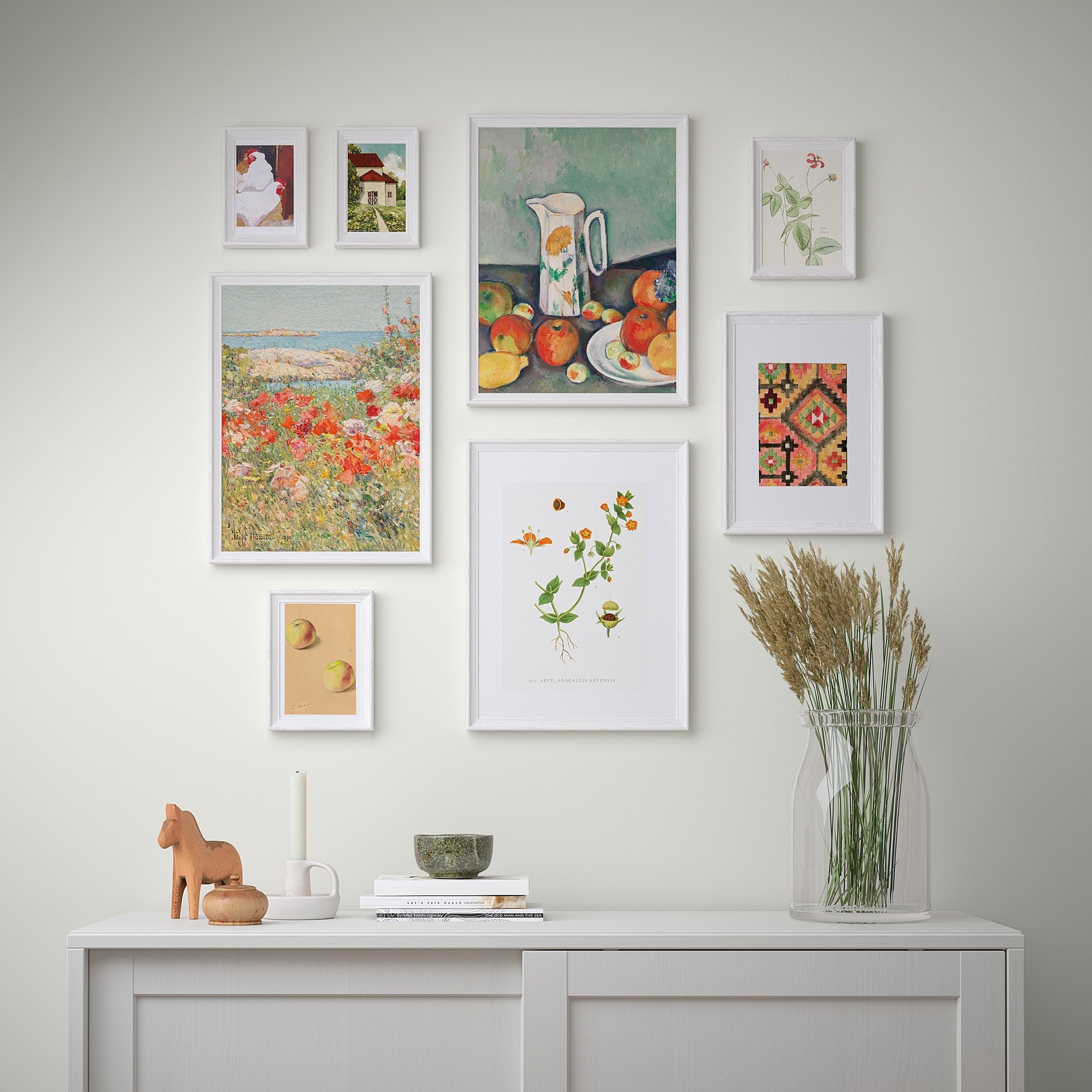 A gallery wall with eight framed posters