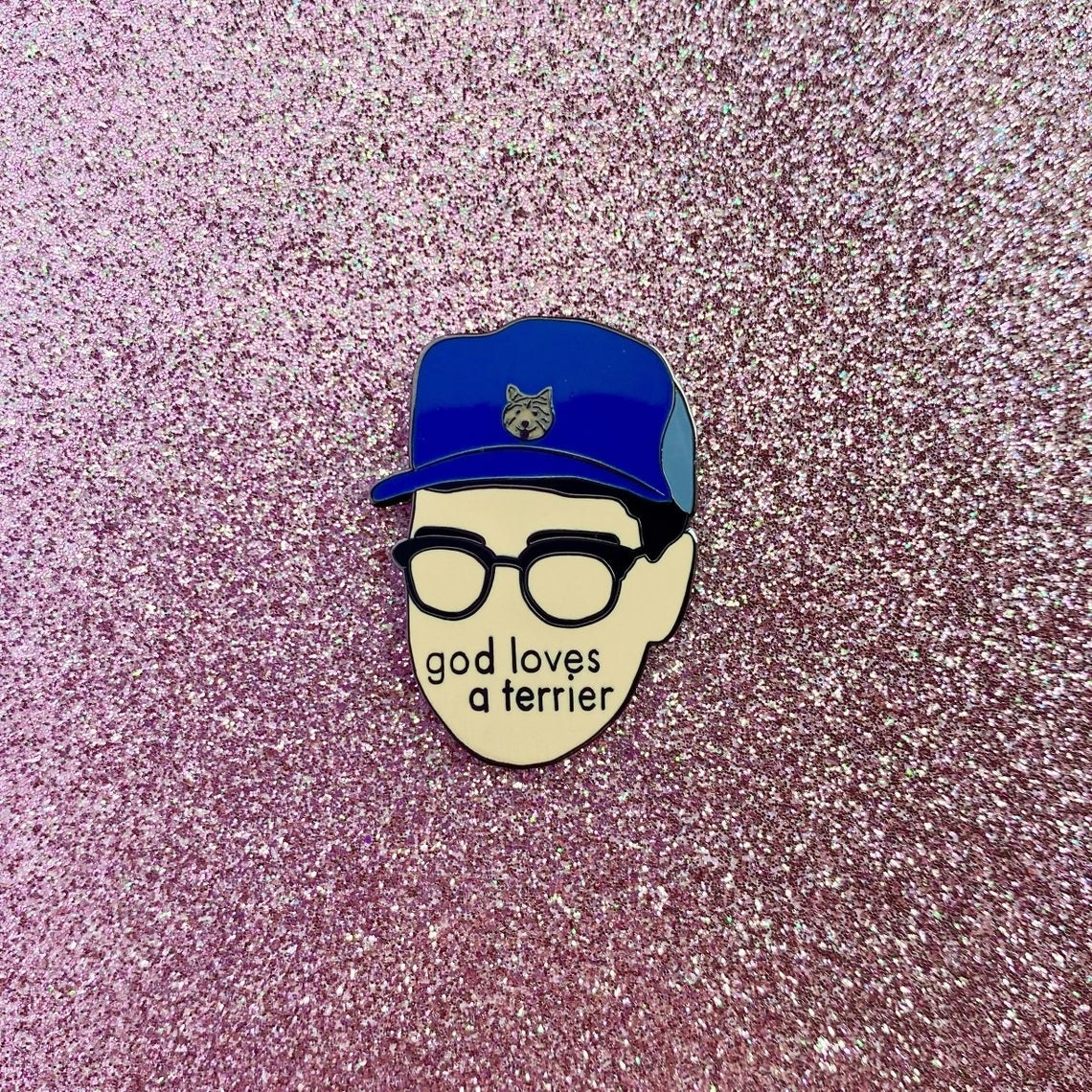 minimalist eugene levy wearinh terrier hat that says god loves a terrier on it