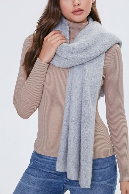 Model wears heather gray scarf with blue jeans and a brown top