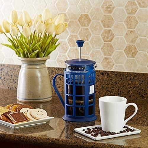 a french press that looks like the blue phonebooth from doctor who