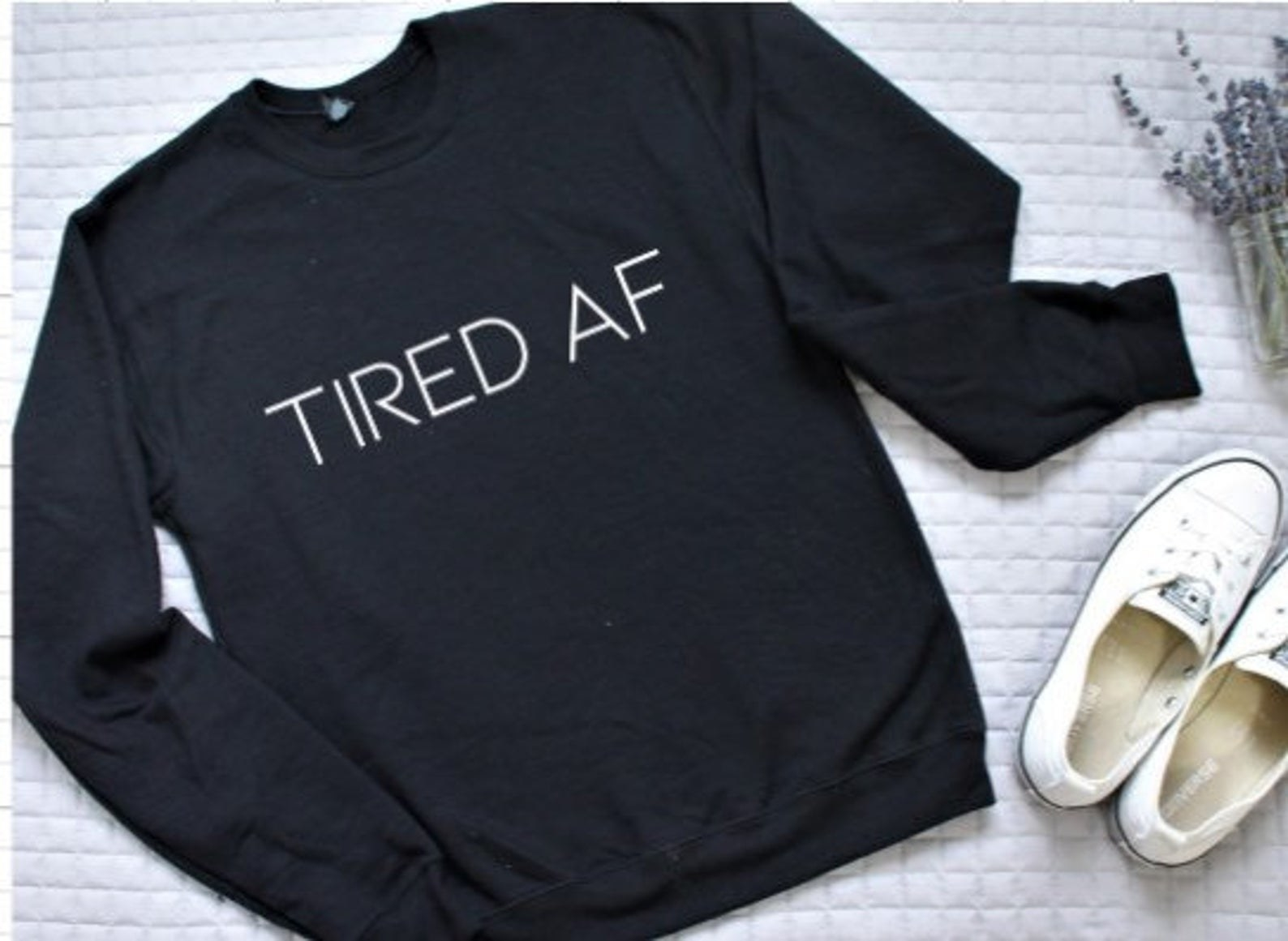 the sweatshirt that says tired AF