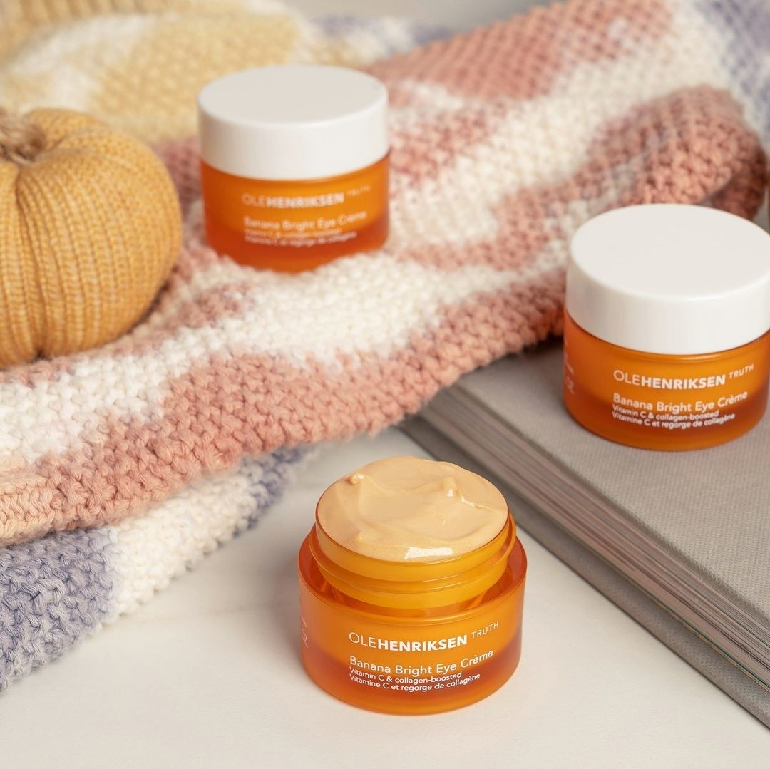 Three small containers of eye cream on a table