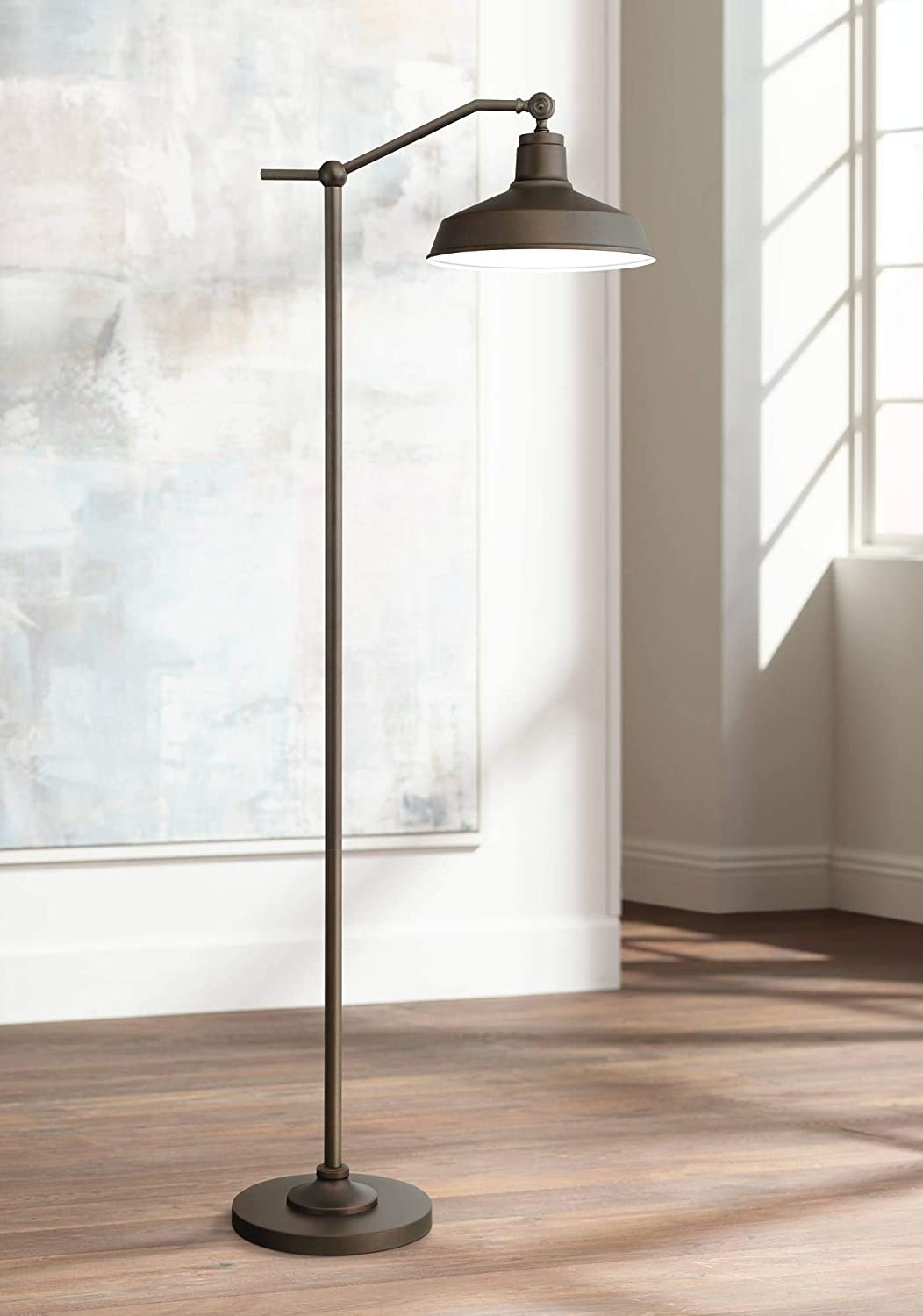 the kayne modern downbridge bronze floor lamp in an empty living space