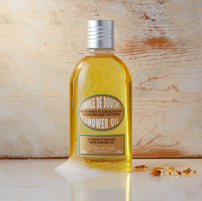 A bottle of shower oil on a counter