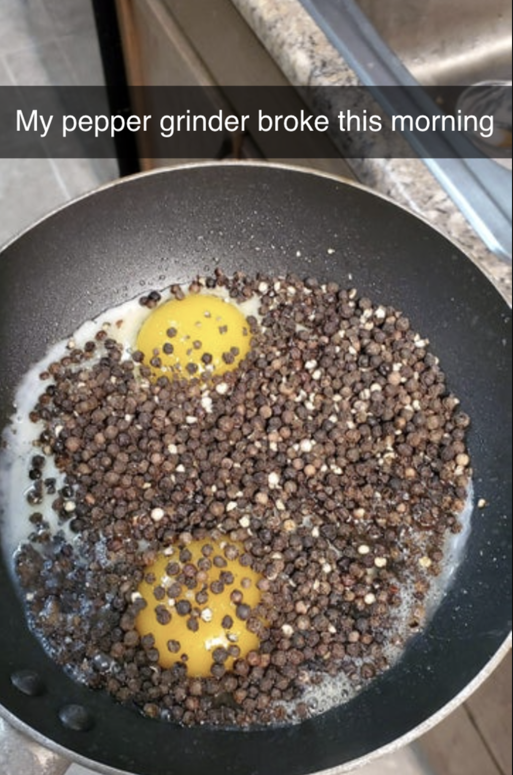 a ton of peppercorns spilled in a frying pan