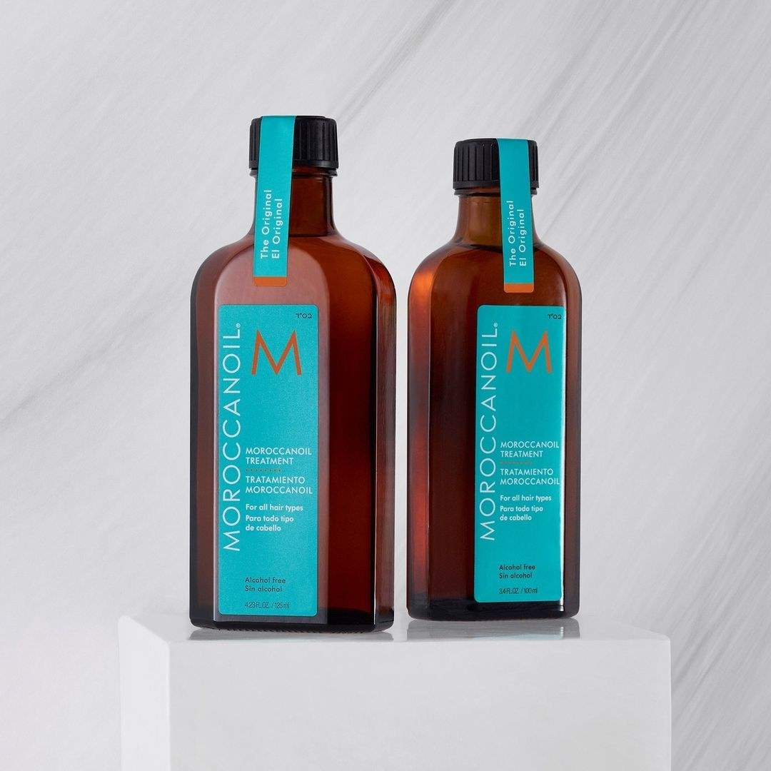 Two bottles of hair oil next to each other