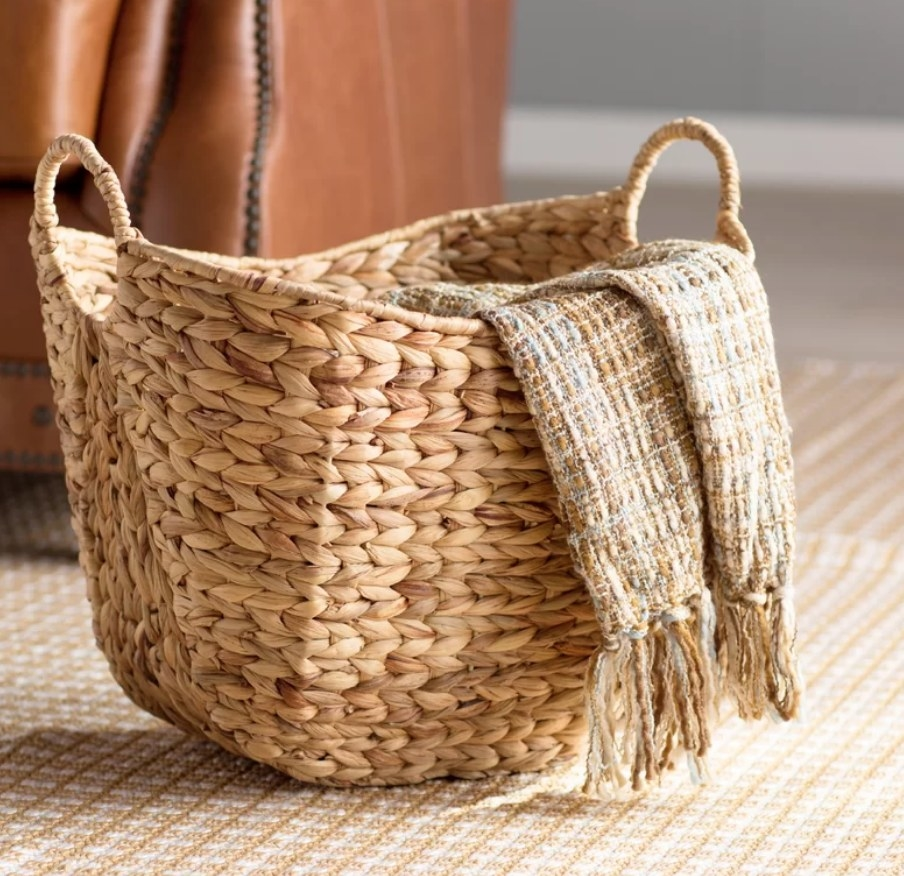 Wicker basket with blanket flowing out
