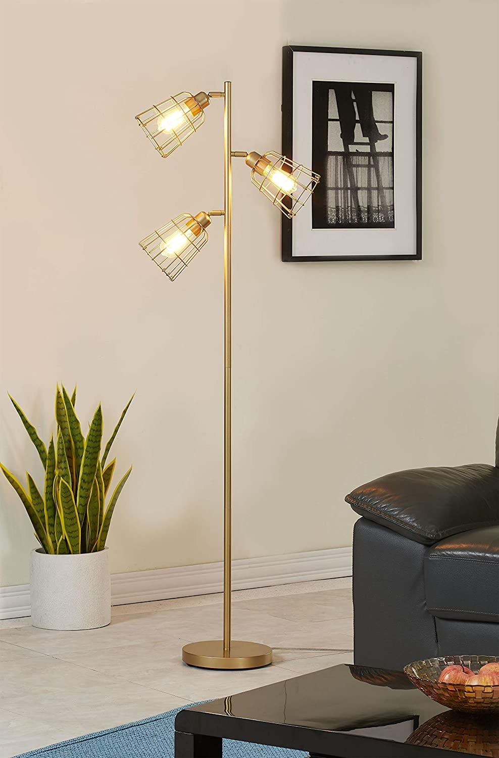 the modern gold tree floor lamp in a living room