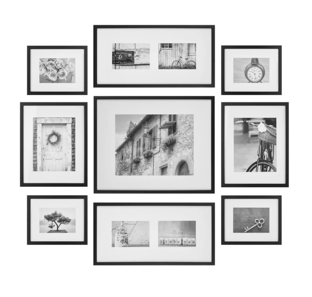 Set of black picture frames with black and white photos