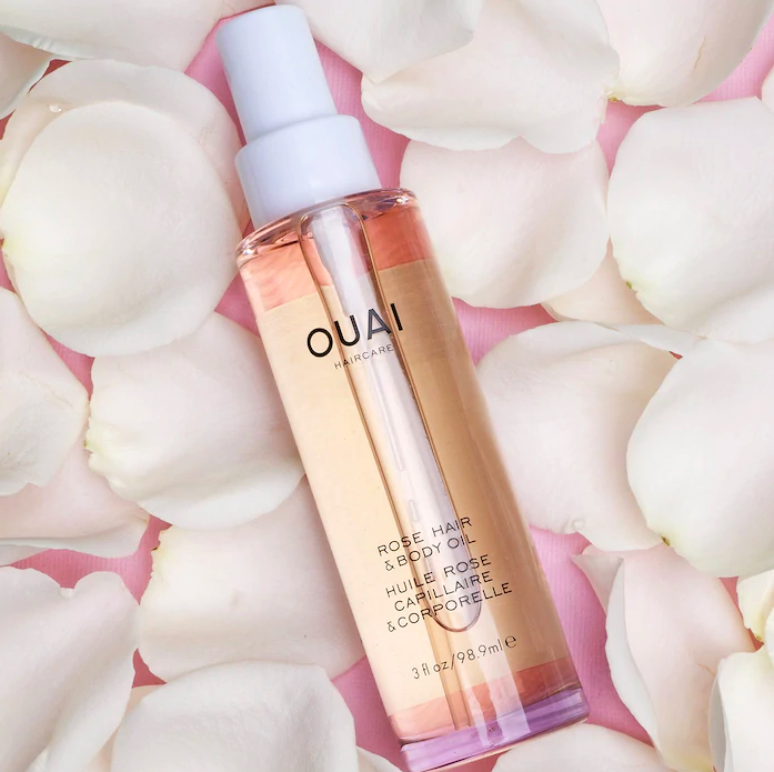 A bottle of oil on a pile of petals