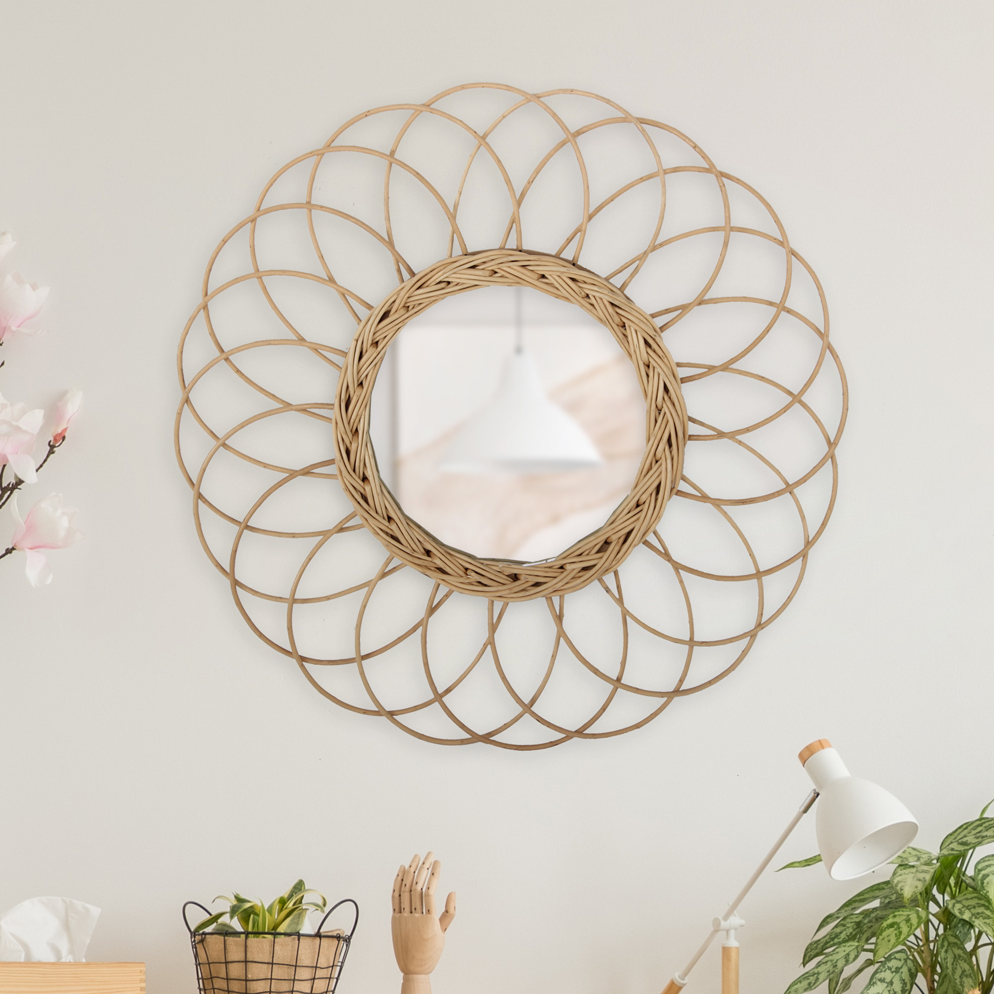 a 20 inch circular willow mirror on a wall