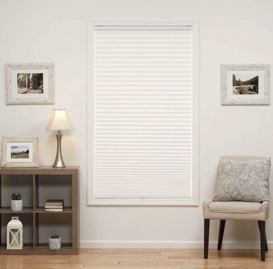 White pull down shades on window