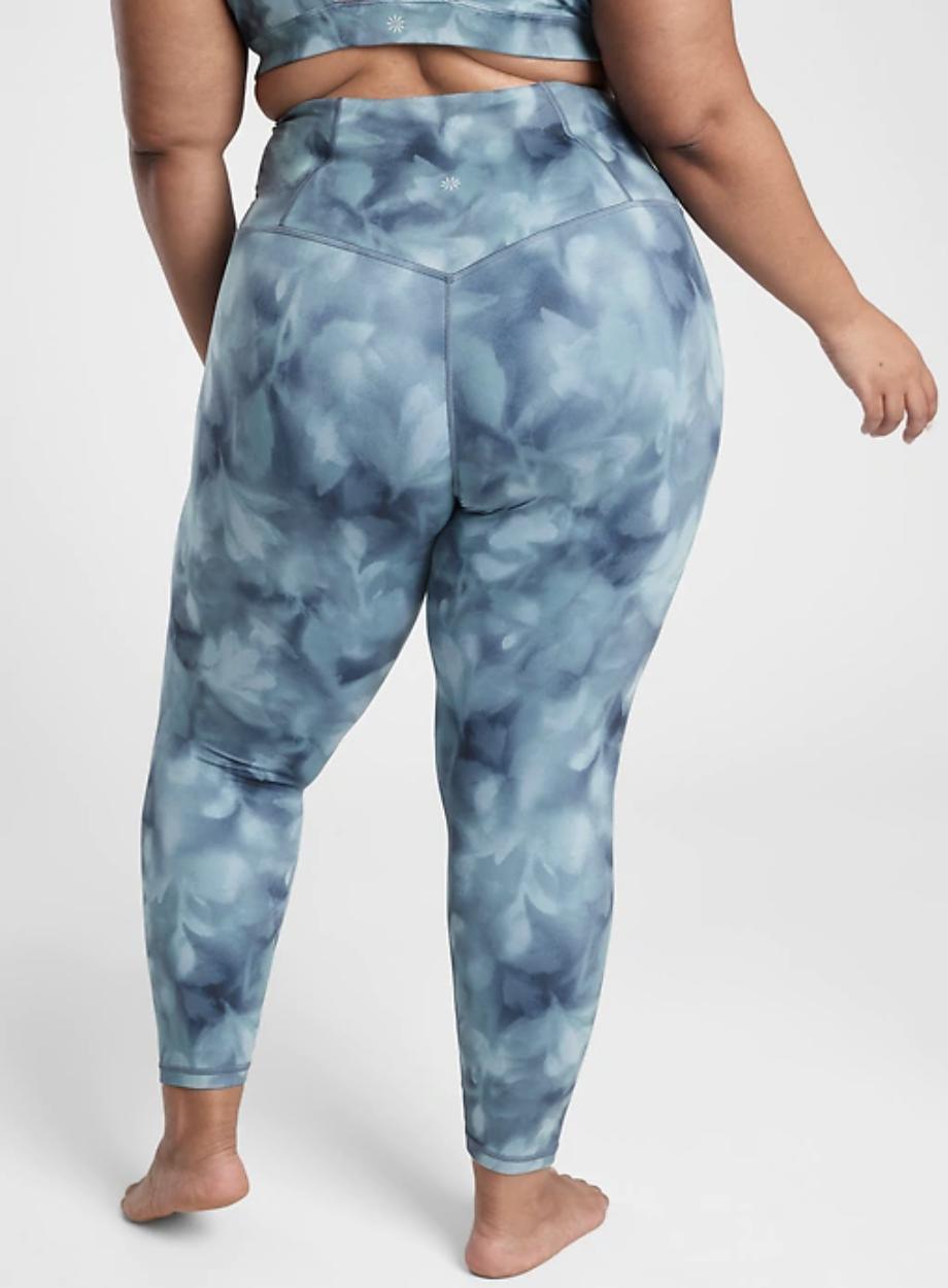 Model wears blue tie-dye leggings with matching bra