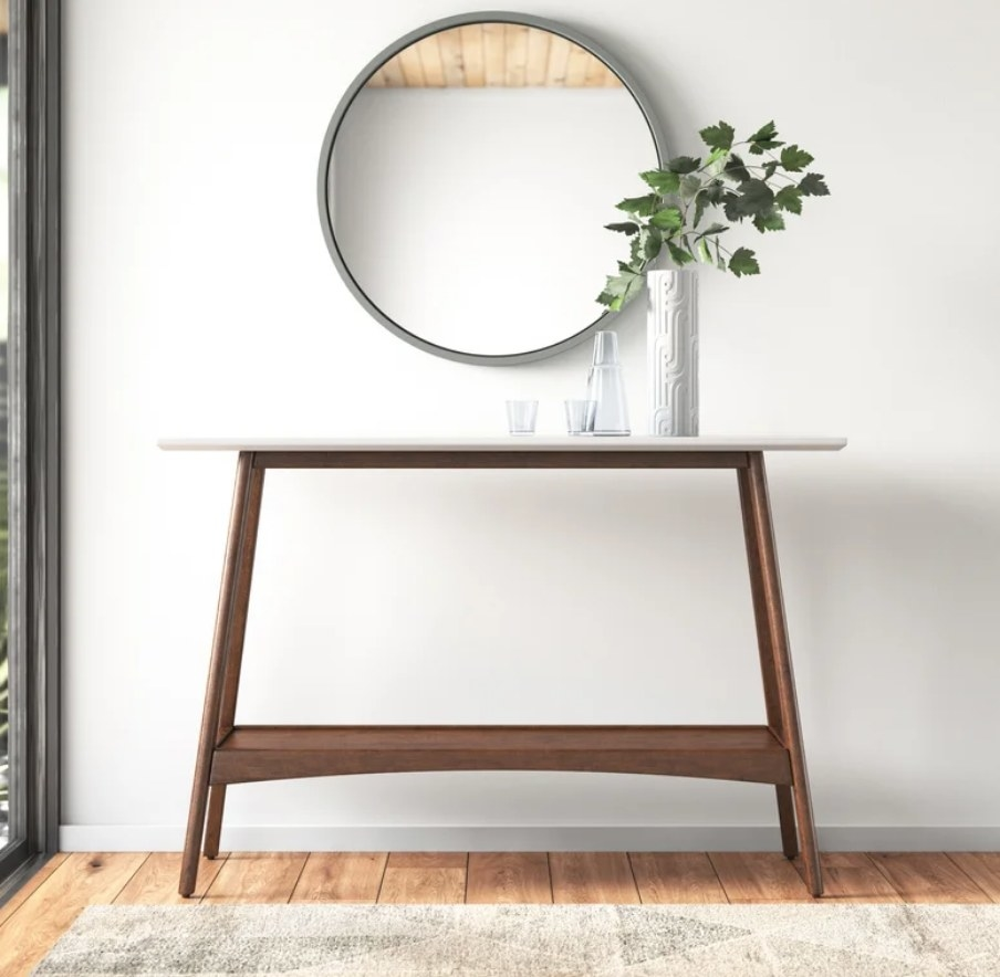 Brown based console table with flat white top