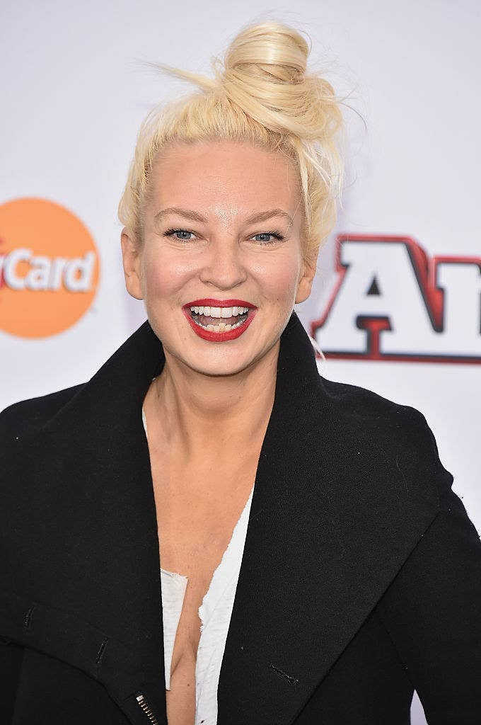 Allison smiling on a red carpet