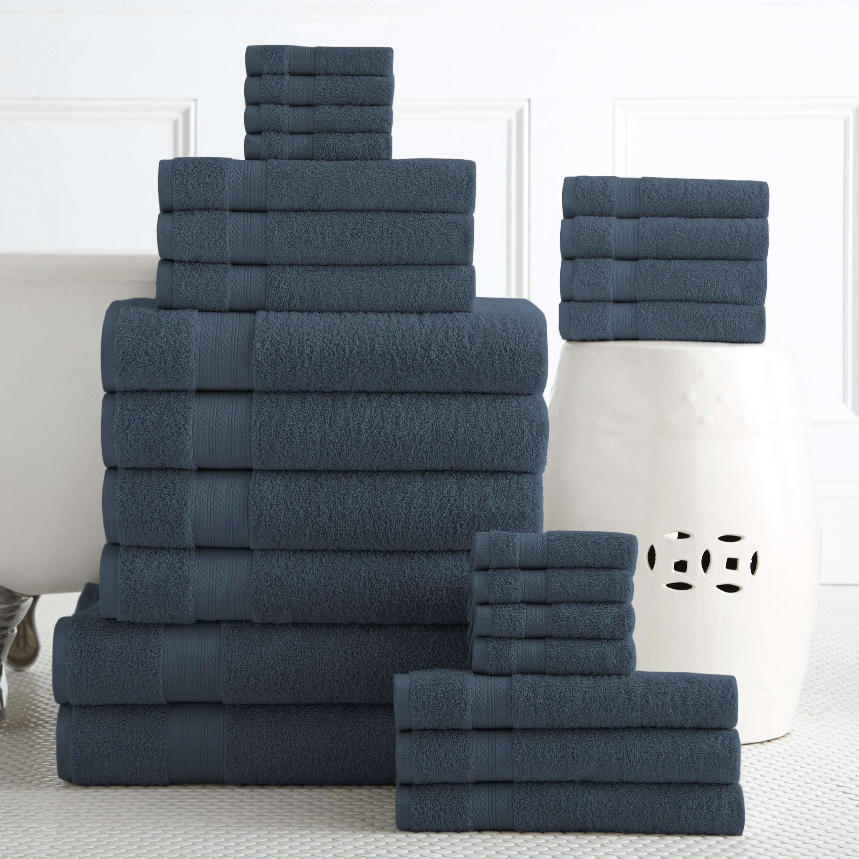 blue towel set folded on a bathroom floor