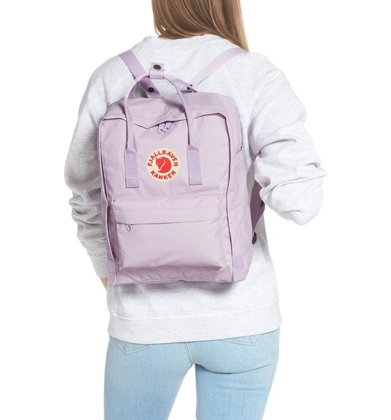 A model sporting the backpack in Pastel Lavender