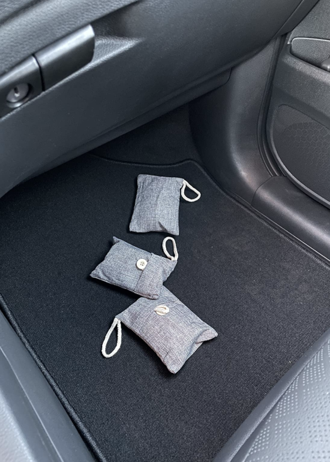 bamboo charcoal purifying bags on floor of reviewer's car