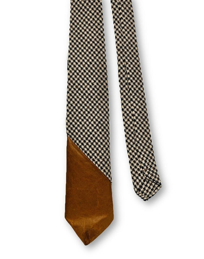 The houndstooth tie with a brown leather tip