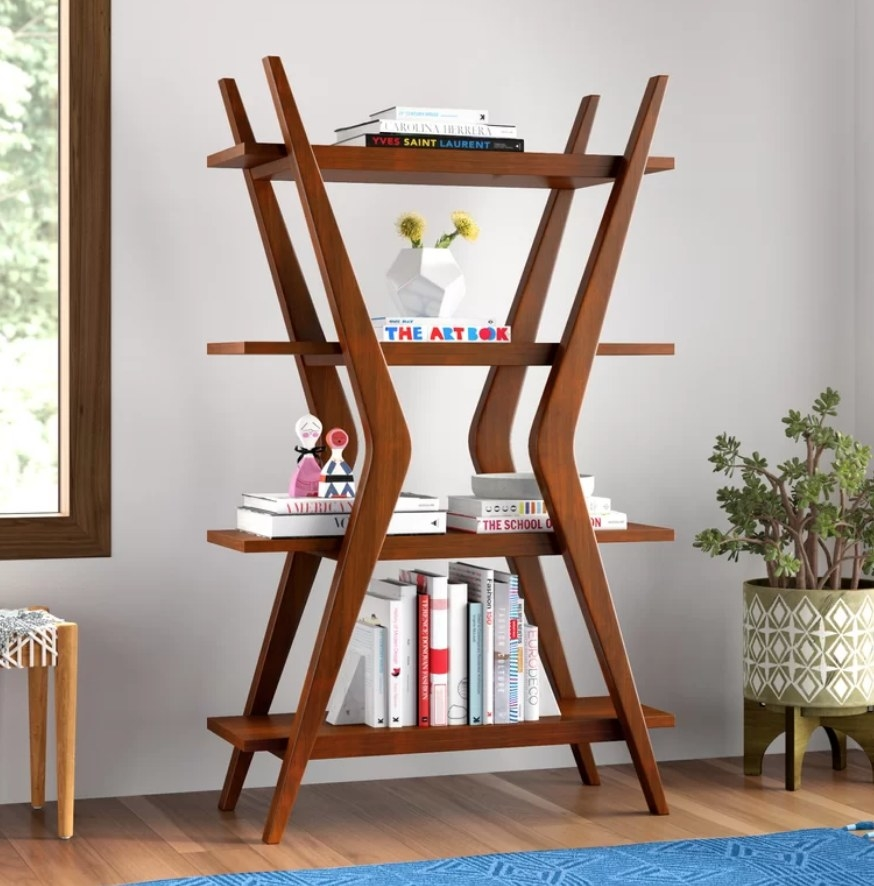 Brown boomerang shaped bookshelf