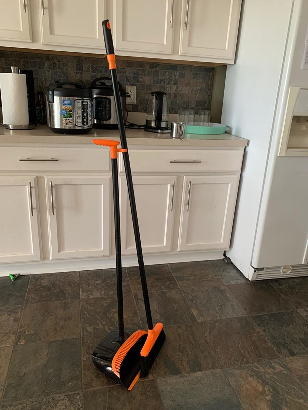 reviewer image of the orange homemaxs broom and dustpan set in a customer's kitchen