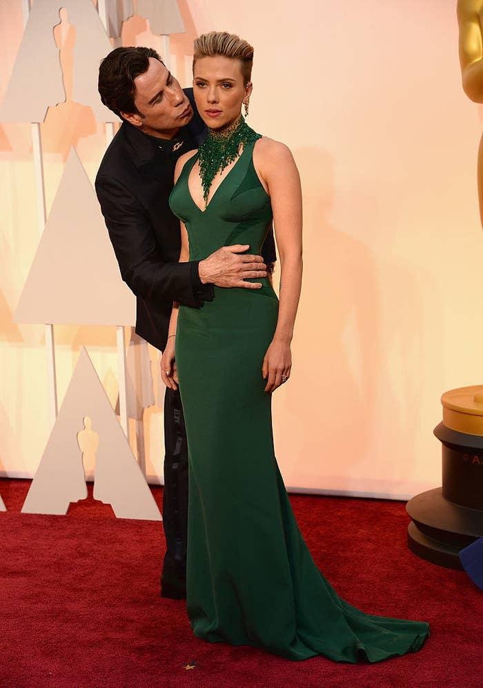 John Travolta creepily behind Scarlett Johansson