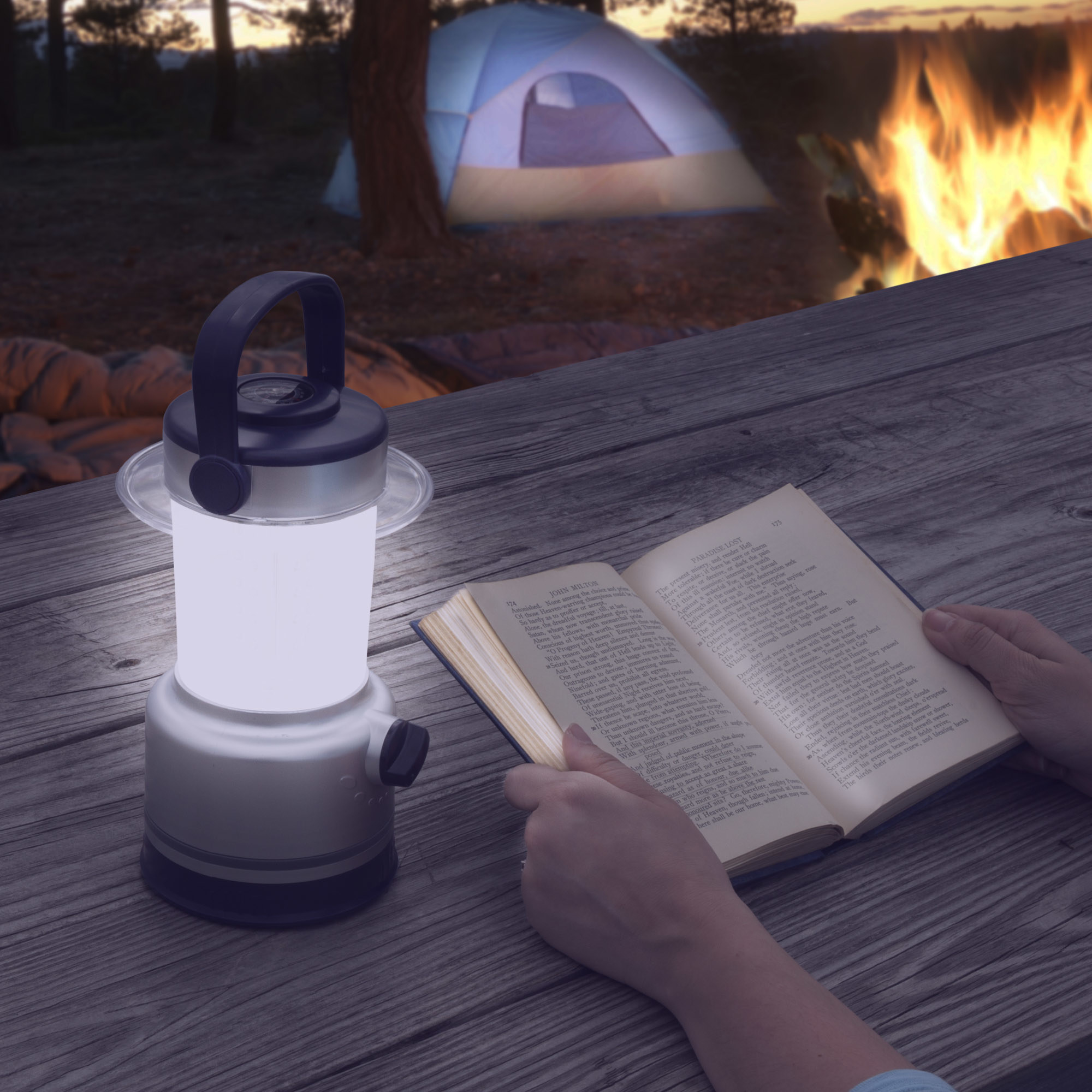 lit-up lantern with someone reading a book in the light it gives off