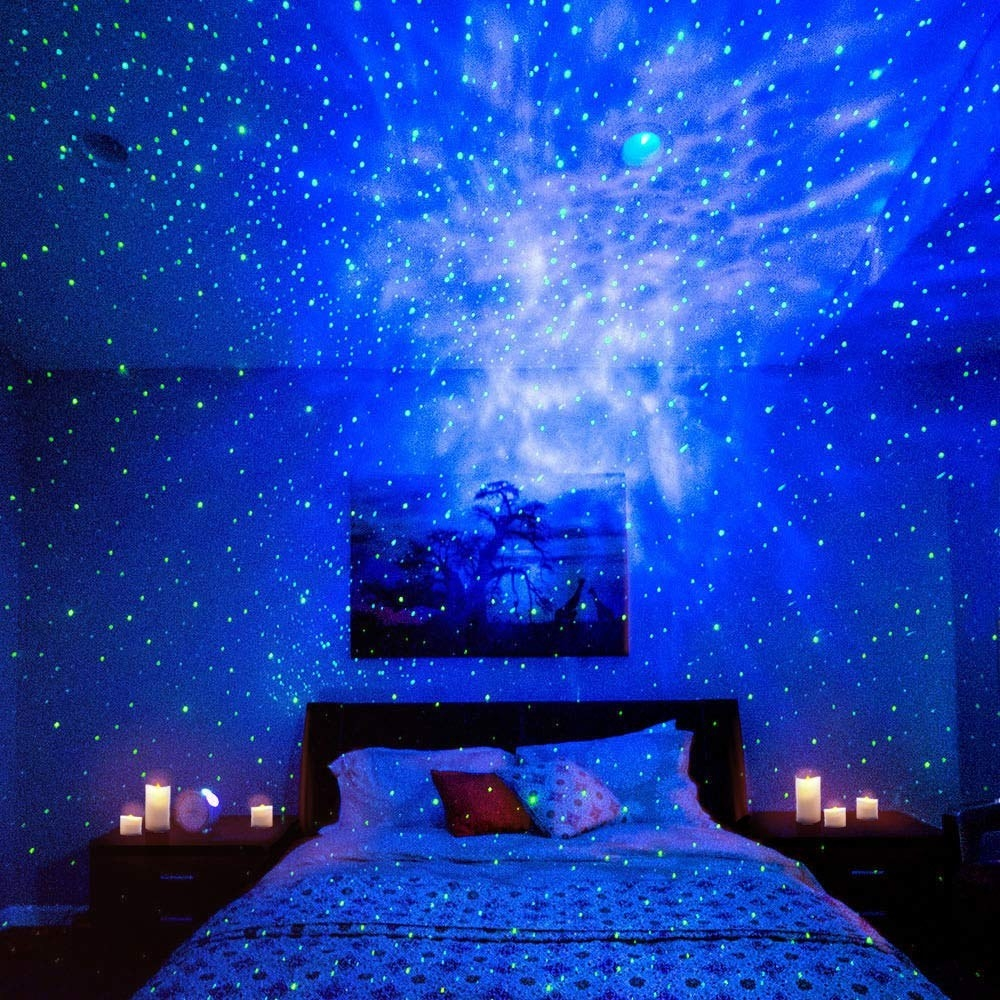 The starry lights projected all over a bedroom