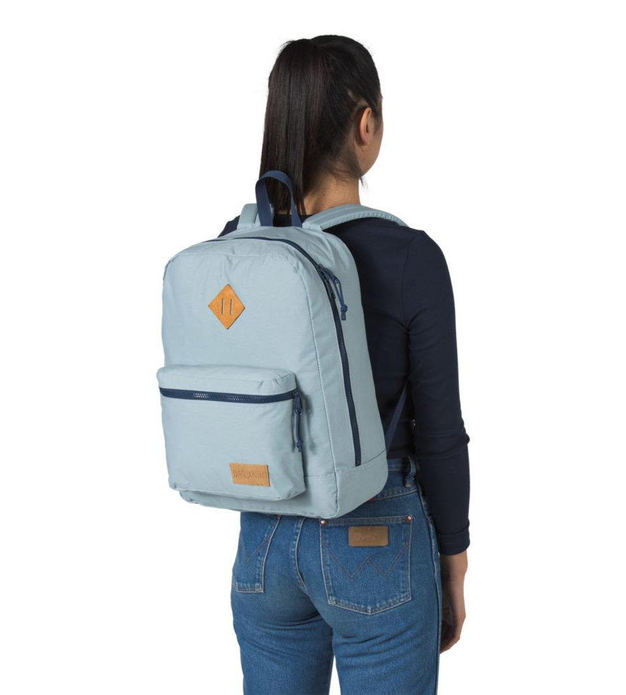 a model in a light blue backpack
