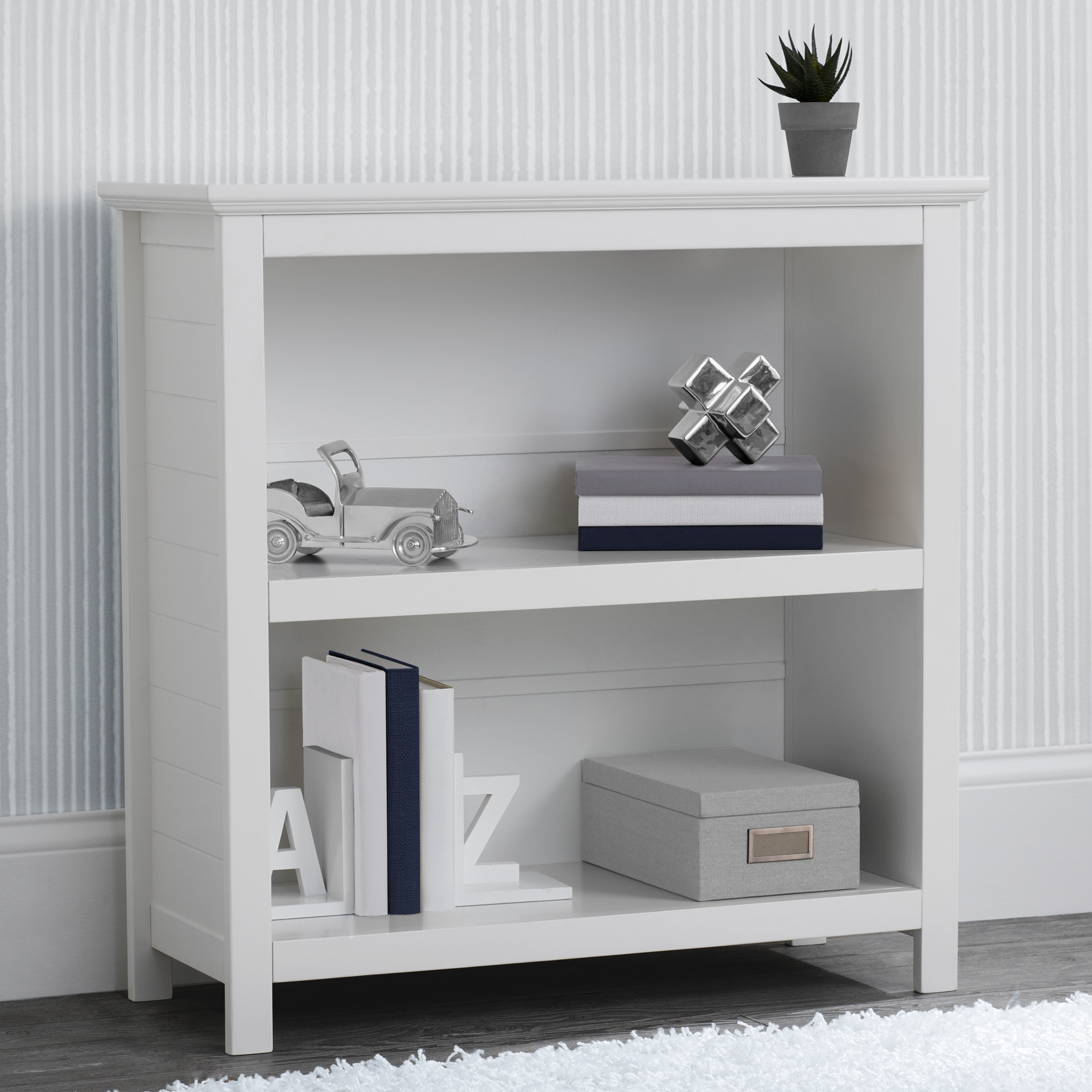 white better homes and gardens bookcase with knick knacks on it