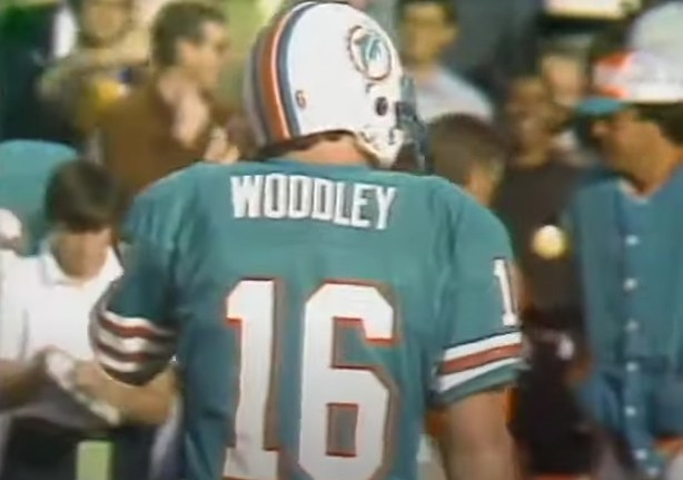 David Woodley's back turned in Dolphins uniform.