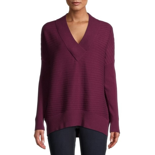 person wearing a plum-colored v-neck sweater