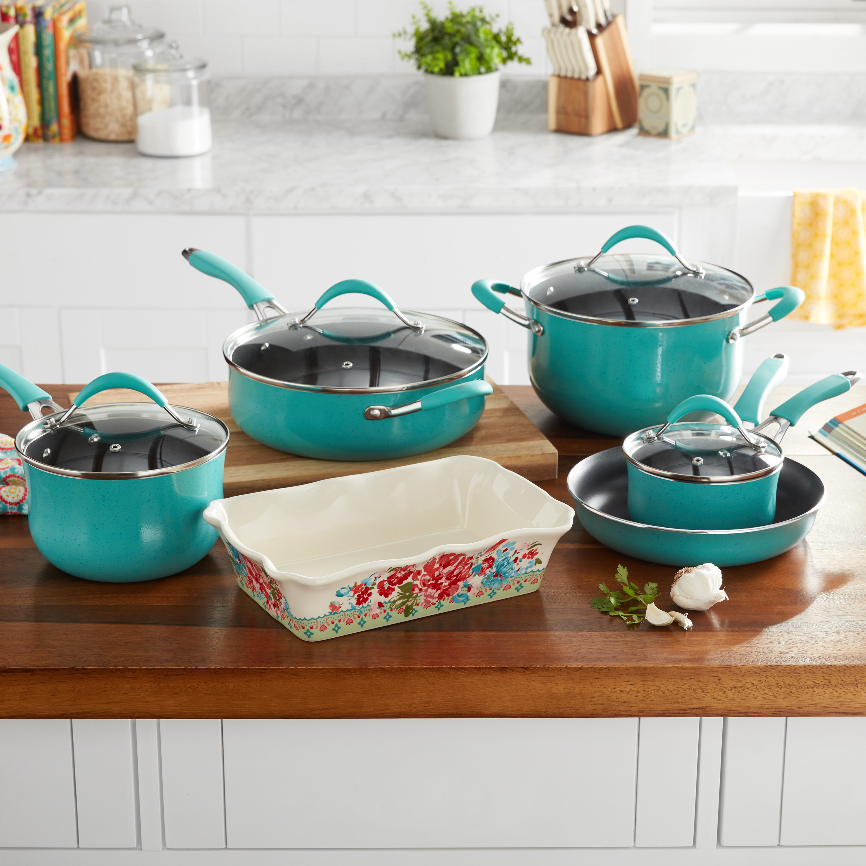 turquoise pots and pans and a white & floral casserole dish