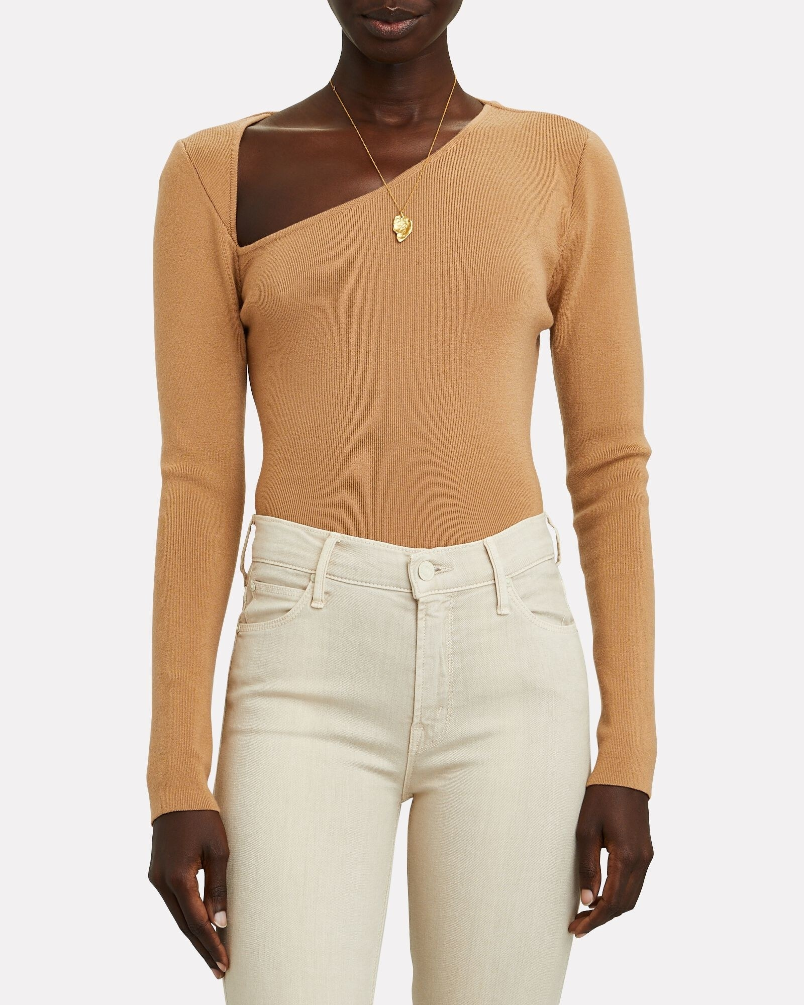 Model wearing the tan long-sleeve thin sweater with an asymmetric V-neckline