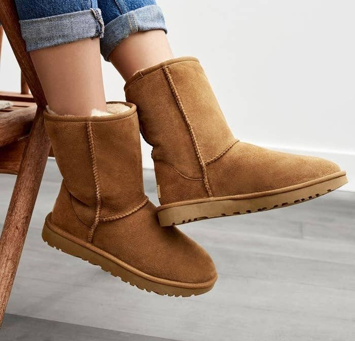 A model wearing the boots in Chestnut Suede