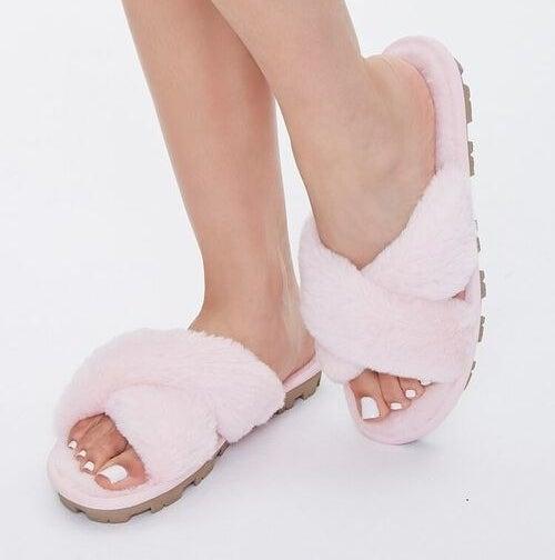 Model wears pink crisscross slippers