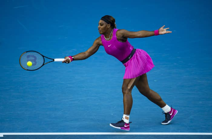 Serena Williams stretches to hit a tennis ball with her racket at the Australian Open Series in Melbourne