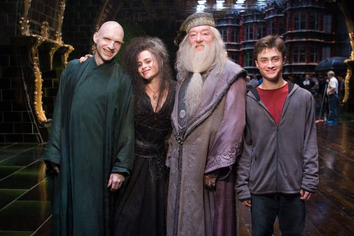 the actors for Voldemort, Bellatrix, Dumbledore, and Harry posing and smiling on the set of the 5th film