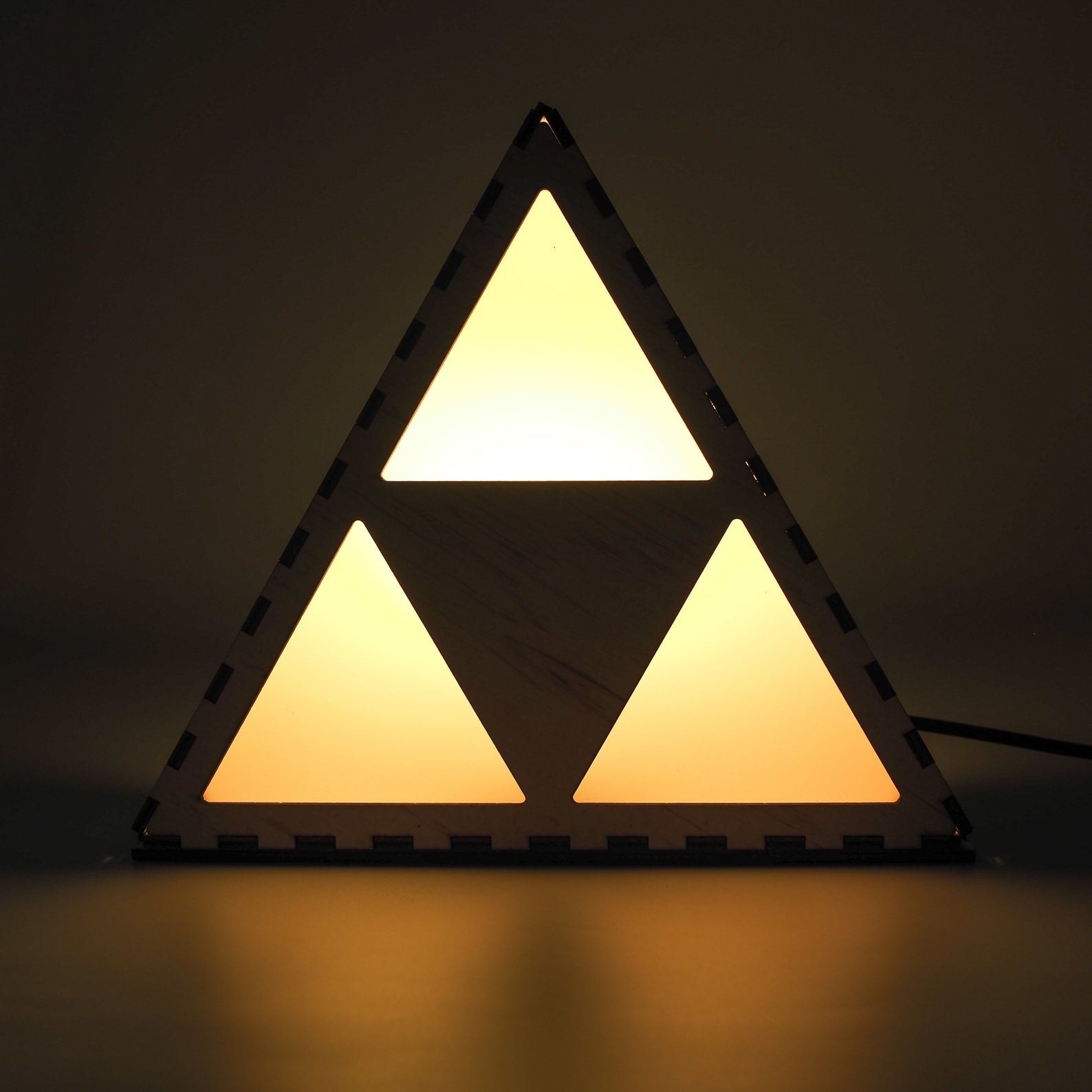 a light shaped like the triforce from zelda