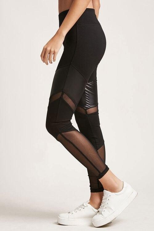 Model wears black mesh leggings with white sneakers