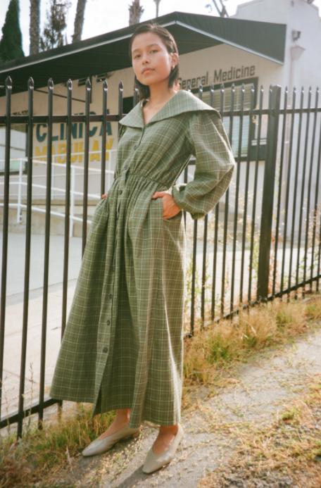 A model wearing the Thielma Dress in plaid