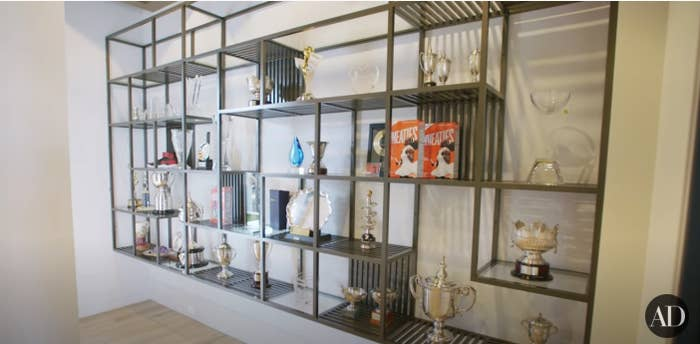 A shelf lined with trophies in Serena Williams' trophy room in her Miami home