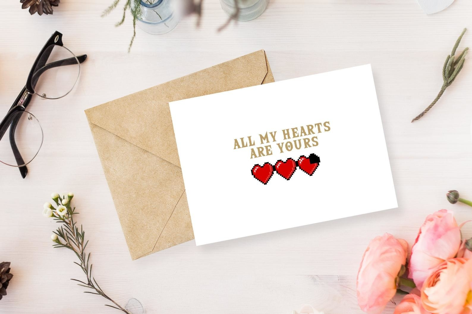 a white card that says all my hearts are yours with three red hearts on it