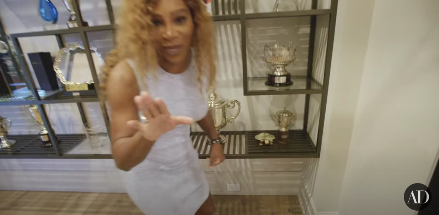 Serena Williams puts her hand up while talking about her trophy room