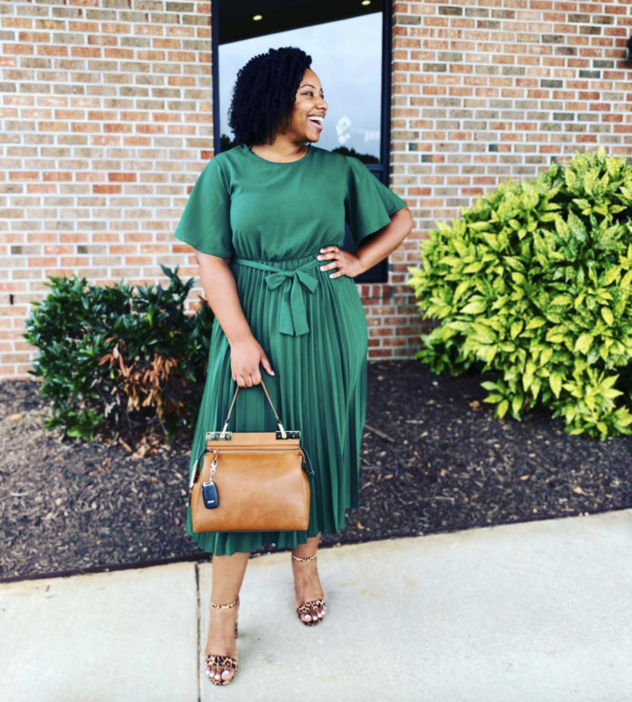 reviewer wearing the dress with a tie waist in green