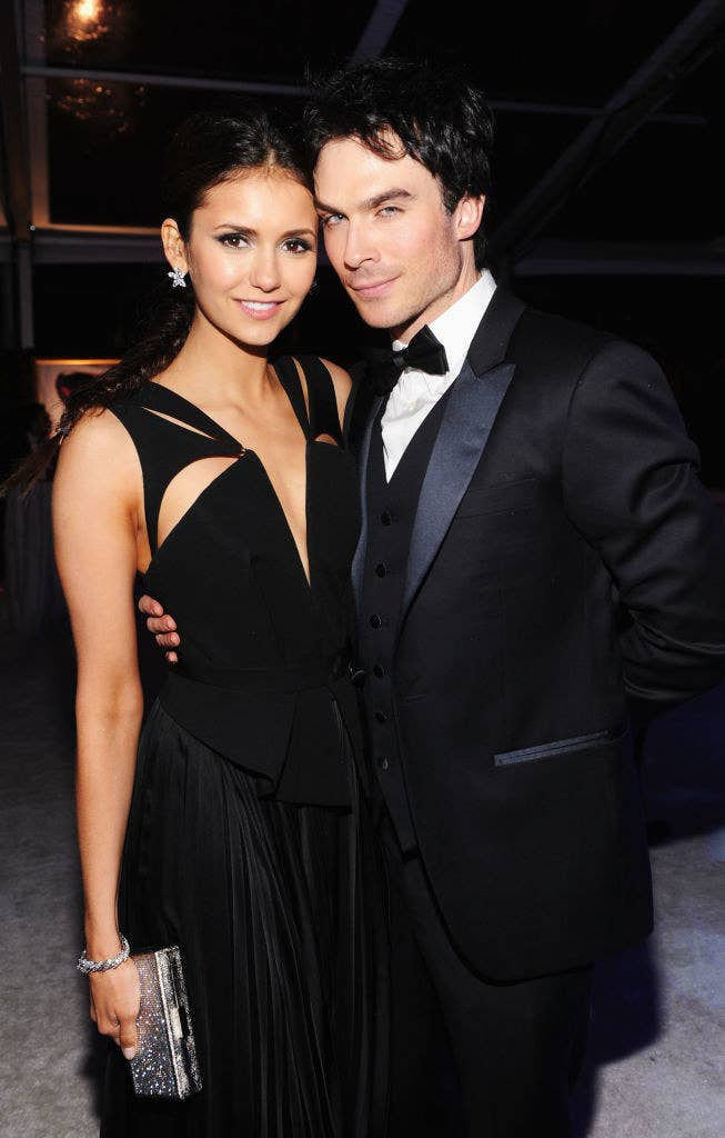 Nina Dobrev, in a low-cut dress, and Ian Somerhalder, in a tux, at the 20th Annual Elton John AIDS Foundation Academy Awards
